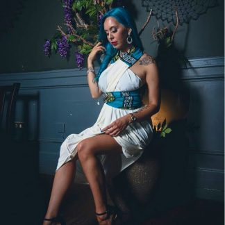 The Azzurro Halter Neck Dress by Disorder. It is very versatile and can be worn in 4 distinctly different styles. Handcrafted in the UK.